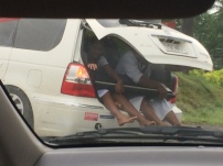 Kids going to church in the back of the car with their keyboard